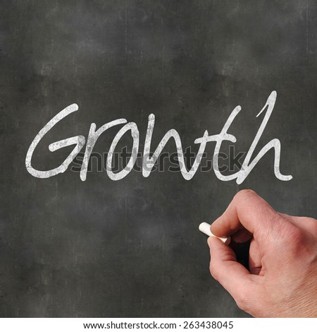 A Colourful 3d Rendered Concept Illustration showing Growth written on a Blackboard - stock photo