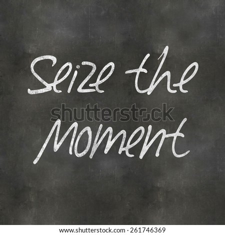 A Colourful 3d Rendered Concept Illustration showing Seize the Moment written on a Blackboard - stock photo