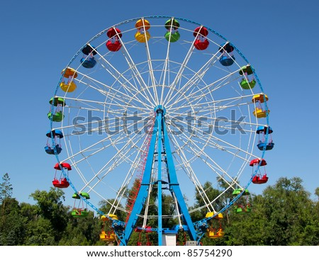 A colourful ferris wheel. Front view - stock photo