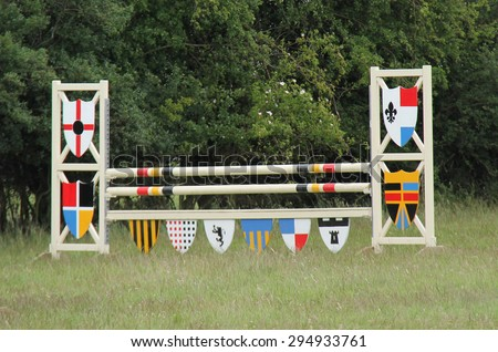 A Colourful Wooden Fence for Horse Show Jumping. - stock photo