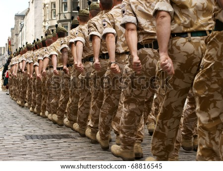 A column of British soldiers on a homecoming march. - stock photo