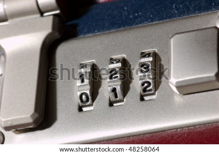 A combination lock on a case - stock photo