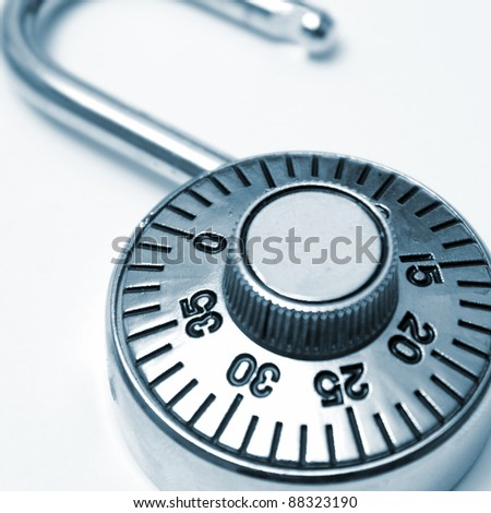 A combination lock that you would use to protect your valuables in square format and in blue tint. - stock photo