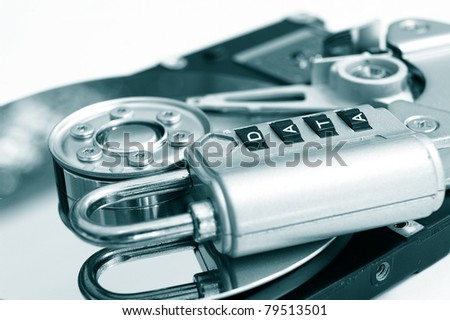"""a combination lock with """"data"""" password on a hard-drive - stock photo"""