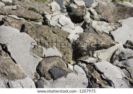 A combination of rocks and concrete blended together as a shoreline defense.