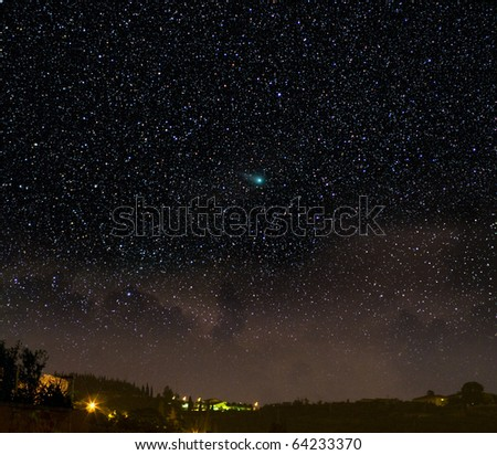 A comet in a night time scene. The Christmas star? - stock photo