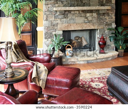 A comfortable living area decorated in leather, stone, and textiles. - stock photo
