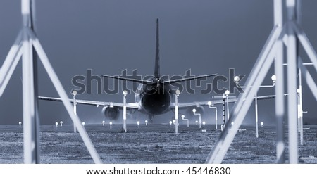A commercial jet plane at full throttle with stormy sky weather conditions. - stock photo