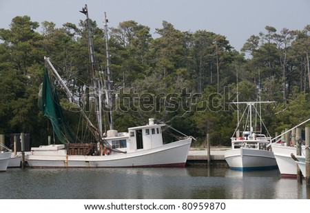 A commercial shrimp boat docked at the ocean - stock photo