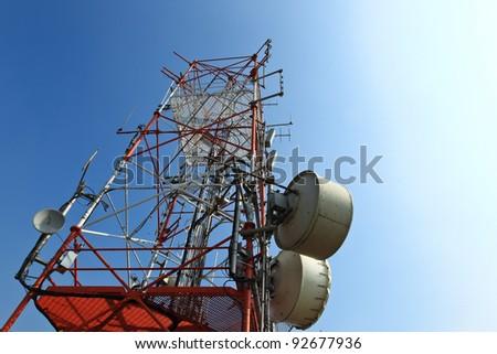 A communication tower under blue sky - stock photo