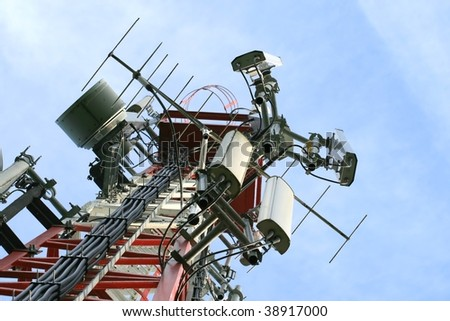 A communications tower for tv and mobile phone signals - stock photo