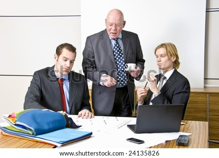 A company director with two of his staff