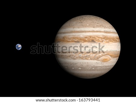 A comparison between the planets Earth and Jupiter on a clean black background. - stock photo