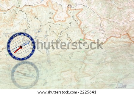 A compass and topographic map reflection - stock photo