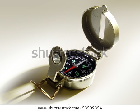 a compass is lighted up a sunbeam - stock photo