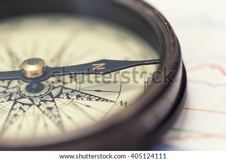 A compass on charts - stock photo