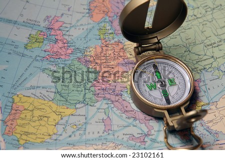 A compass on the map of the European continent.