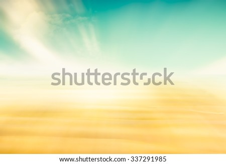 A complete abstraction of sand and sky.  Image features a yellow to green color gradient. - stock photo