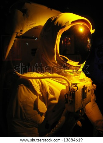 A complete astronaut setup under dramatic lighting. - stock photo