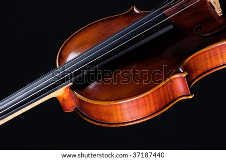 A complete violin viola isolated against a black background in the horizontal format with copy space. - stock photo