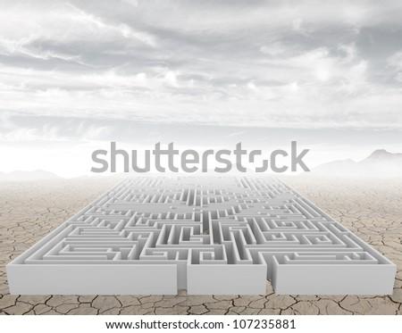 A complicated maze in a arid desert - stock photo