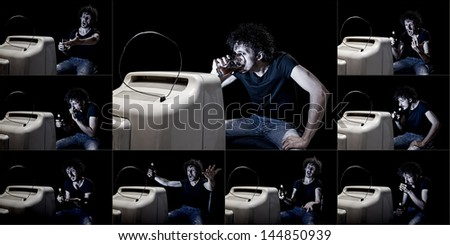 a composite of a man watching tv alone - stock photo