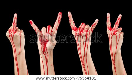 A composite of 4 bloody covered hands making various gestures isolated on black. - stock photo