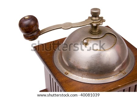 A composition of a coffee grinder on a white background
