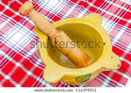 A composition of a mortar and pestle