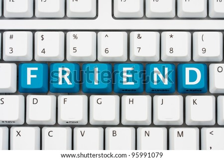 A computer keyboard with blue keys spelling friend, Communicating with friends on the internet