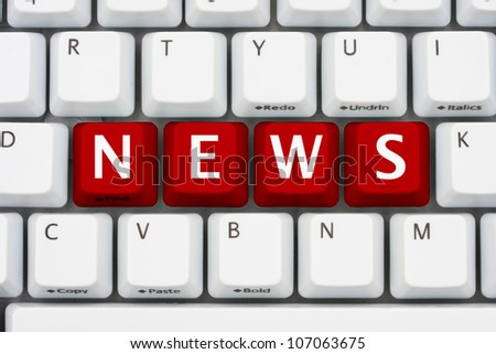 A computer keyboard with red keys spelling news, Getting your news on the internet - stock photo