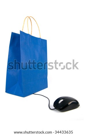 A computer mouse going to a shopping bag on white background - stock photo