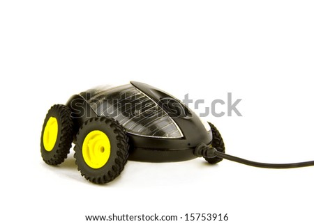 a computer mouse on wheels on white background - stock photo