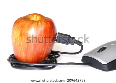 A computer mouse plugged into an apple for an online learning concept. - stock photo