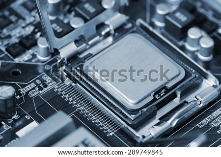 A computer processor with the motherboard and components. Technology concept. - stock photo