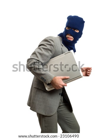 A computer thief is getting away with a laptop - stock photo