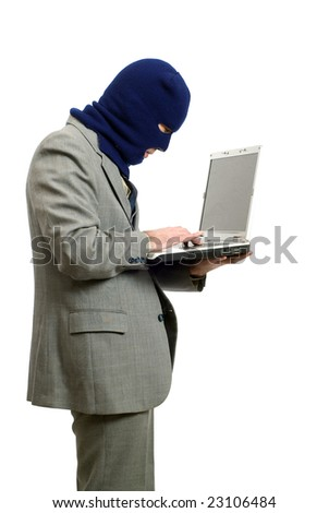 A computer thief wearing a business suit is stealing private information - stock photo
