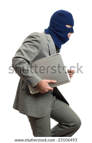 A computer thief with a balaclava - stock photo
