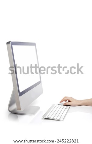 A computer with blank(empty) screen and A female(woman) hand touch the keyboard and mouse isolated white at the studio. - stock photo