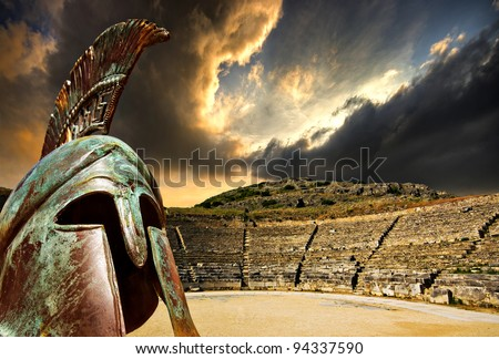 a concept image for ancient greece featuring the amphitheatre  at philippi and an overlaid replica war helmet