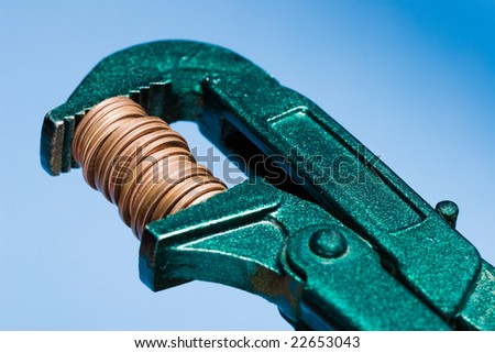 A concept image for shrinking the budget. Blue background - stock photo