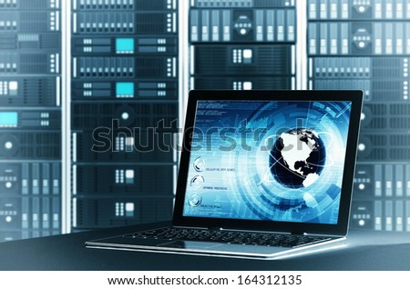 A concept of controlling  worldwide information sharing on a  server rack via laptop interface. You can change the laptop screen to suit your need. - stock photo