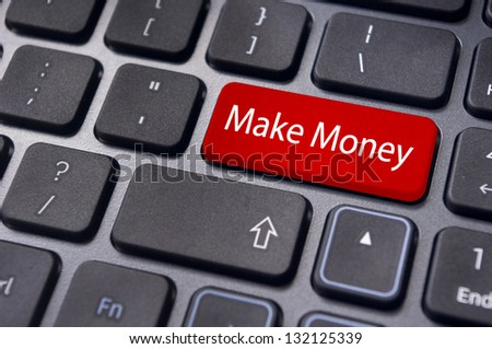 a concept of making money online, with message on enter key of keyboard. - stock photo