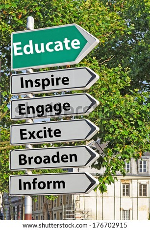 A concept road sign pointing in the direction of 'Educate' with some descriptive words underneath - stock photo