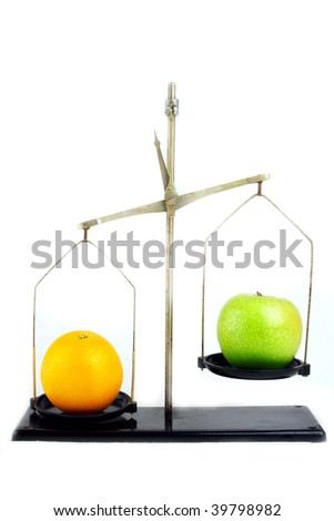 A concept  showing an apple and an orange on scales. - stock photo