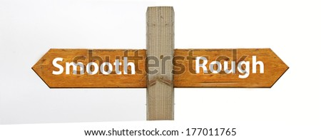 A concept signpost pointing to smooth or rough - stock photo