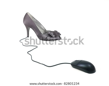 A conceptual ecommerce image of a shoe and a computer mouse - stock photo