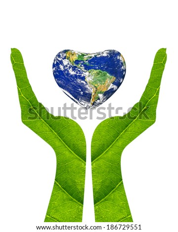 A conceptual for loving the world, the globe in the heart shape on woman hands made of green leaf isolated on a white background.Elements of this image furnished by NASA - stock photo