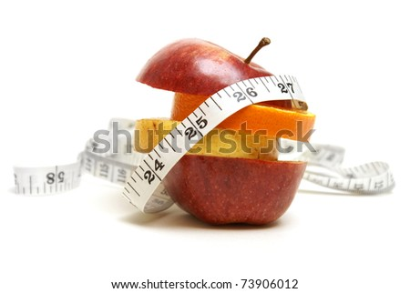 A conceptual fruit of fitness with various fruits and a measuring tape.