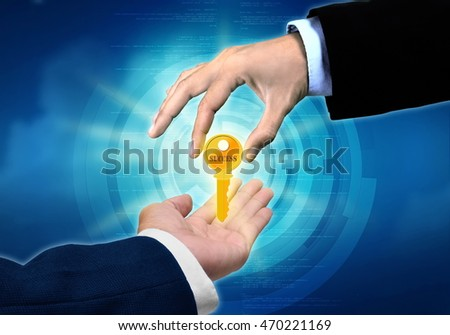 A conceptual image of a businessman hand  giving his key of success to other businessman